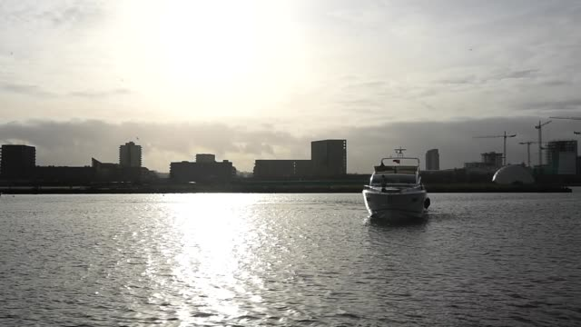 a boat sails down the river thames towards excel london so it can be displayed at the london boat show at excel on december 18 2015 in london england... - london boat show stock videos and b-roll footage