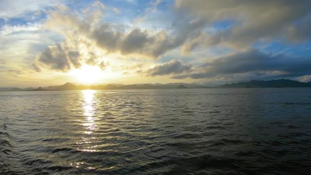 ws boat pov sea at sunset, lesser sunda islands, nusa tenggara province, indonesia - seascape stock videos & royalty-free footage