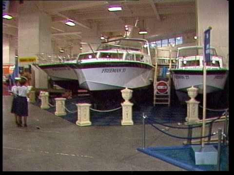 Boat show during economic depression ENGLAND London Earls Court Show TS Boats in harbour MS Reva Yacht MS Bed on boat MS Woman sets dining table MS...