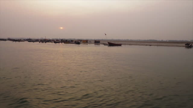 boat silhouettes along the ganga at sunset, india - river stock videos & royalty-free footage