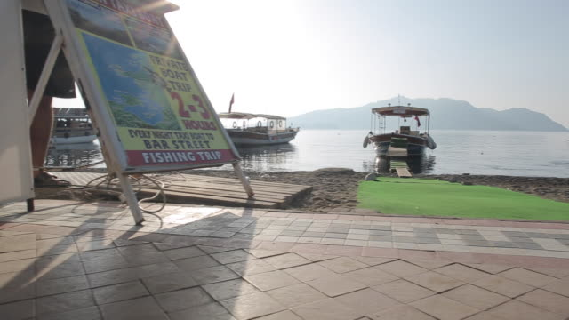 boat taxi and beach scene, marmaris, anatolia, turkey - marmaris stock videos & royalty-free footage