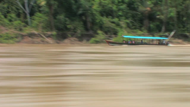 SM WS boat POV tourboat on river/ Manu National Park, Peru