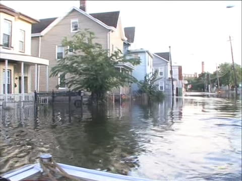 boat touring the flooded streets through patterson new jersey under water in the wake of hurricane irene. hurricane irene of 2011 was an atlantic... - north carolina us state stock videos & royalty-free footage
