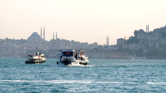 boat traffic on bosphorus strait - suleymaniye mosque stock videos and b-roll footage