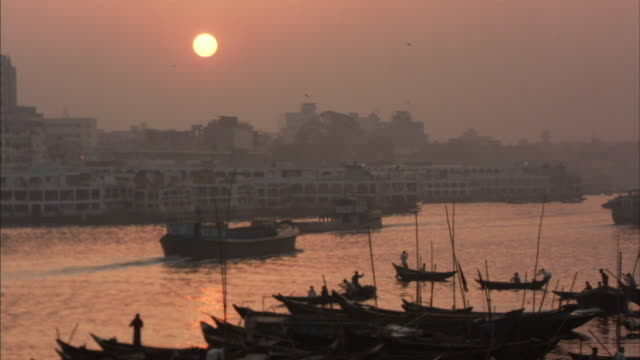 MS, Boat traffic on Buriganga river at sunset, Dhaka, Bangladesh