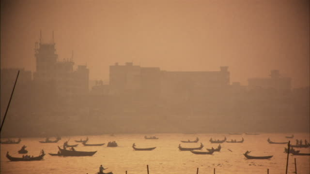 WS, Boat traffic on Buriganga river at sunset, Dhaka, Bangladesh