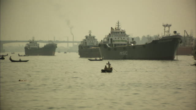 WS, Boat traffic on Buriganga river, smoke stacks in background, Dhaka, Bangladesh