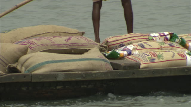 a boat transports bags of spices in kochi, india. - spice stock videos & royalty-free footage