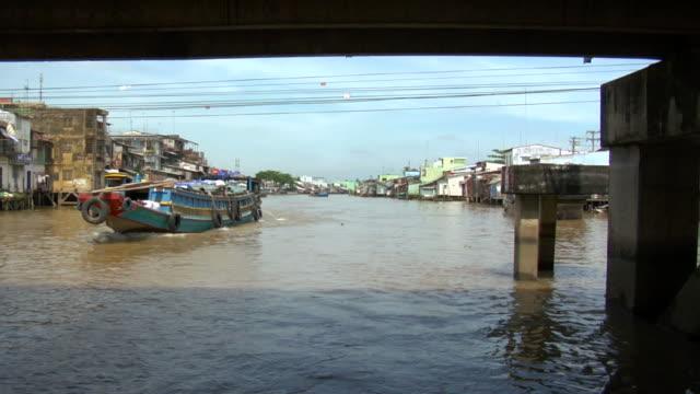 ws pov boat traveling mekong river, south of saigon / vietnam - south vietnam stock videos & royalty-free footage