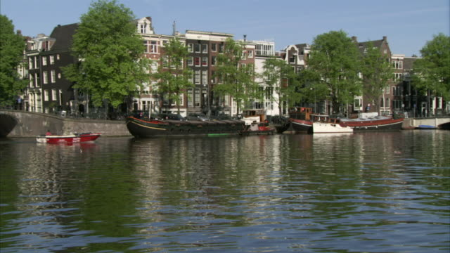 WS Boat traveling on Amstel River / Amsterdam, Netherlands