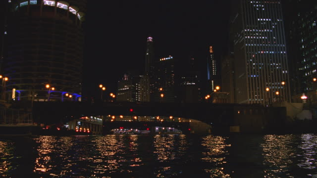 pov boat traveling on chicago river at night / chicago, illinois - chicago river stock videos & royalty-free footage