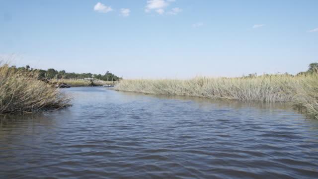 WS SLO MO POV boat traveling on marsh river / Charleston, South Carolina, USA