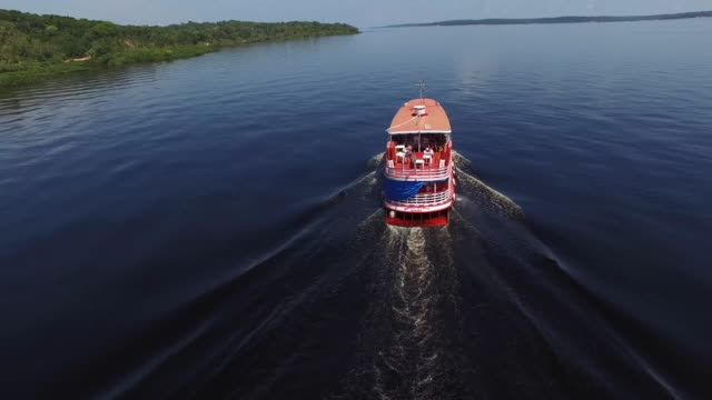 boat traveling over rio negro in amazon, brazil - local landmark stock videos & royalty-free footage