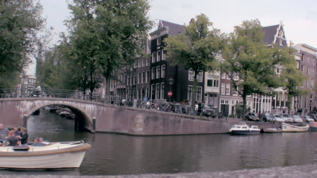 WS T/L Boat traveling through canal / Amsterdam, Netherlands