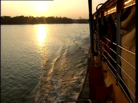 boat travelling along river at sunset - bangladesh stock videos & royalty-free footage