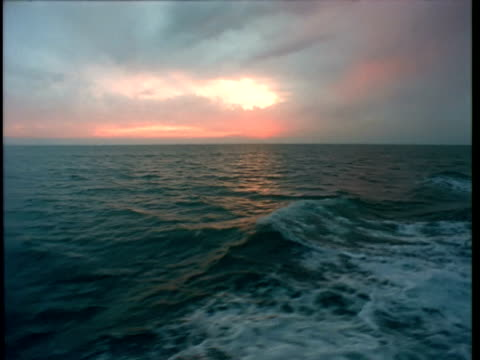 rear pov boat travelling through ocean at sunset - boat point of view stock videos & royalty-free footage