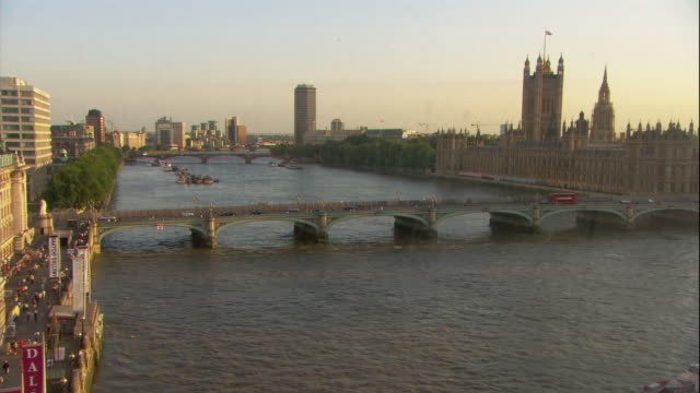 a boat travels down the thames river. - city of westminster london stock videos & royalty-free footage