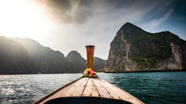 boat trip in tropical islands - thailand - longtail boat stock videos & royalty-free footage