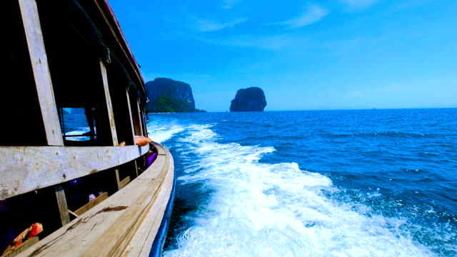 boat trip in tropical lagoon at railay, krabi, thailand - longtail boat stock videos & royalty-free footage