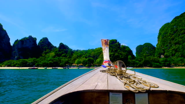 boat trip in tropical lagoon at railay, krabi, thailand - thailand stock videos and b-roll footage