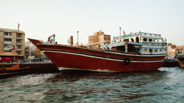 boat trip on the dubai creek - temple building stock videos & royalty-free footage