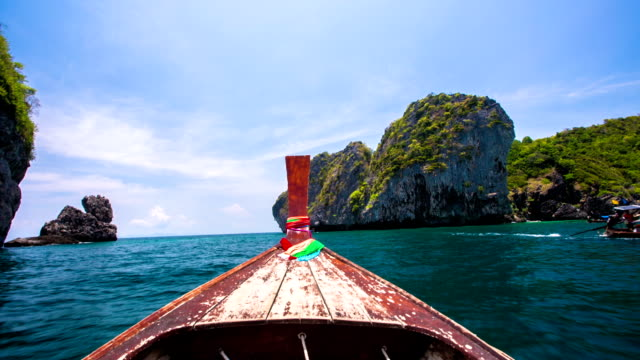 boat trip to tropical islands - longtail boat stock videos & royalty-free footage