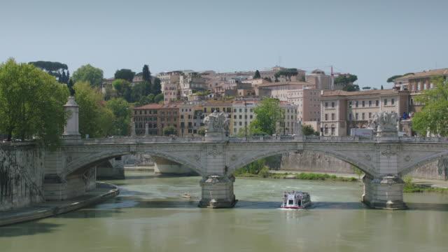 ws boat under ponte vittorio emanuele ii / rome, italy - ponte stock videos & royalty-free footage