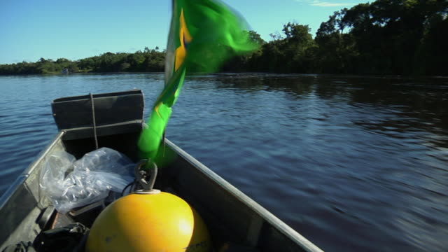 cu pan boat with brazilian flag on river negro / sao gabriel da cachoeira, amazonas, brazil - cachoeira stock videos and b-roll footage