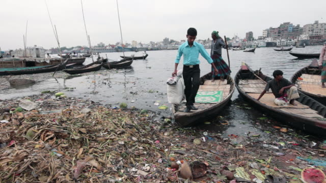 A boat with one passenger  arrives at the Sadarghat Boat Terminal after passing the river Buriganga, Sadarghat Boat Terminal, Dhaka, Bangladesh, Indian Sub-Continent, Asia