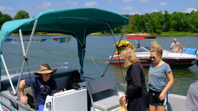 a boat with tibetan prayer flags docks briefly at monroe lake's paynetown boat sunday august 16 near bloomington indiana a car was driven into the... - boat ramp stock videos & royalty-free footage