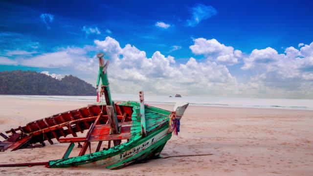 boat wreck on beach at koh payam at ranong, thailand. - stranded stock videos and b-roll footage