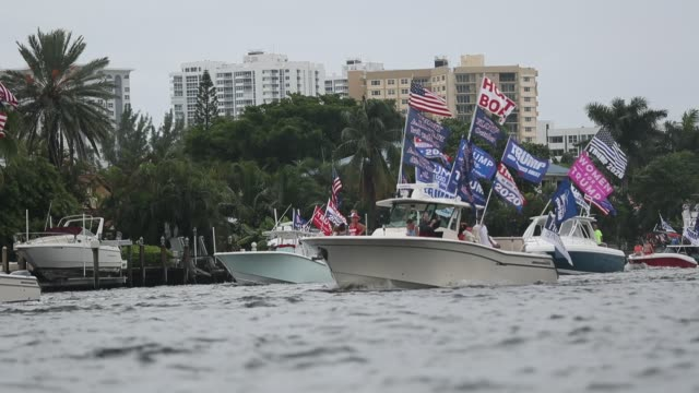 boaters show their support for president donald trump during a parade down the intracoastal waterway on october 3, 2020 in fort lauderdale, florida.... - ベセスダ点の映像素材/bロール