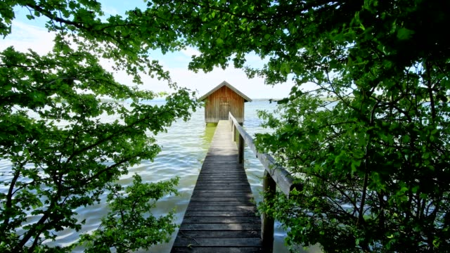 Boathouse on Lake Ammersee in spring, Fuenfseenland, Upper Bavaria, Germany