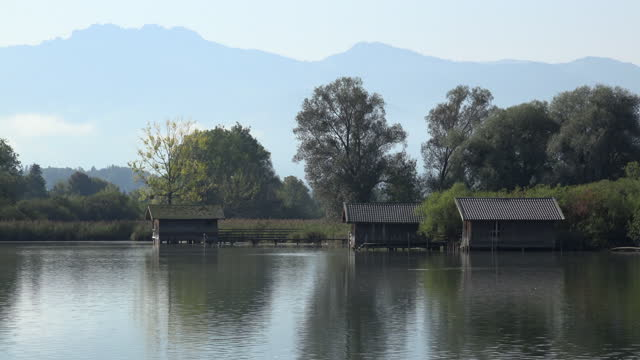 boathouse on lake chiemsee in front of the bavarian alps - bavarian alps stock videos & royalty-free footage