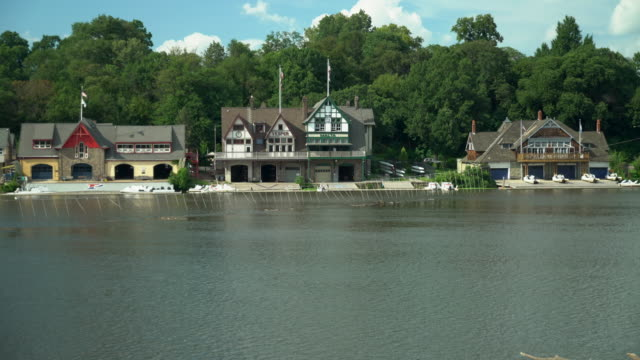 boathouse row and the schuylkill river - cars parked in a row stock videos & royalty-free footage