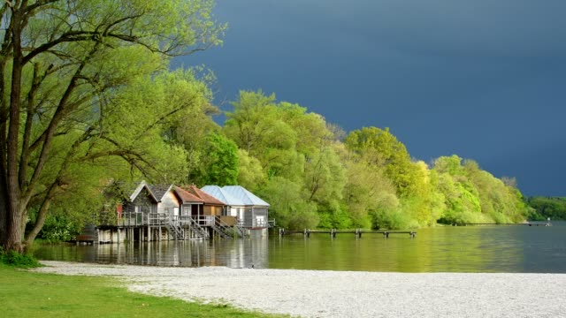 boathouses on lake ammersee in spring, inning stegen, fuenfseenland, upper bavaria, bavaria, germany - inning stock videos & royalty-free footage