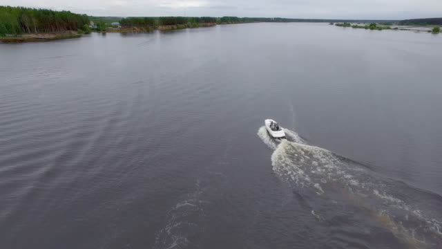boating on river - aerial view - power boat stock videos & royalty-free footage
