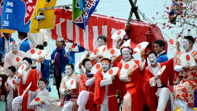 A boatload of dancing fishermen with their faces powdered white and dressed women's robes took center stage at the seaborne Ose Matsuri festival held...