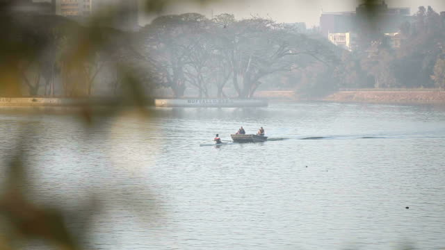 boatride by the rising sun - bangalore stock videos and b-roll footage