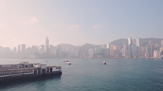stockvideo's en b-roll-footage met boats adrift on the calm waters at victoria harbour in hong kong on a foggy day - wide shot - hong kong