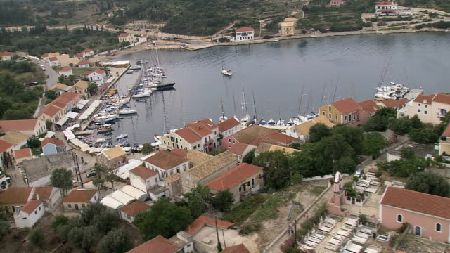 stockvideo's en b-roll-footage met ms aerial tu of boats anchored in fiscardo at small harbour village in kefalonia / kefalonia, ionian islands, greece  - anchored