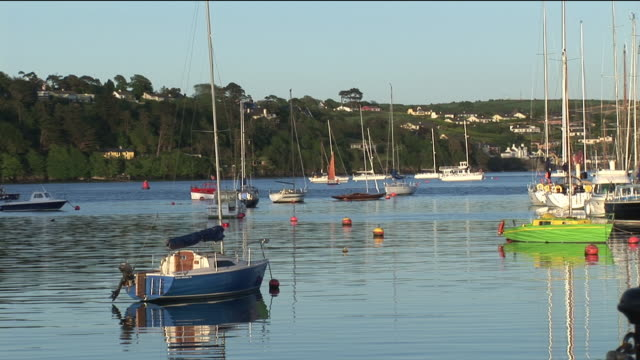 ms, boats anchored in harbor, kinsale, ireland - anchored stock videos & royalty-free footage
