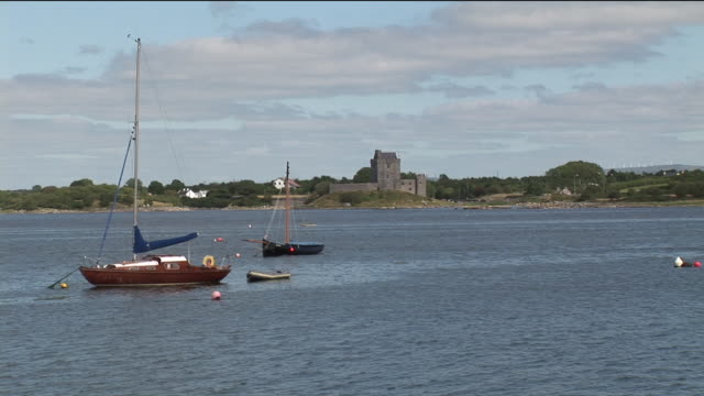 ws, boats anchored in lake, ruins of fort in background, galway county, ireland - anchored stock videos & royalty-free footage