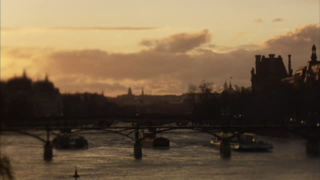 WS SELECTIVE FOCUS Boats and Pont des Arts on river Seine at sunset, Paris, France
