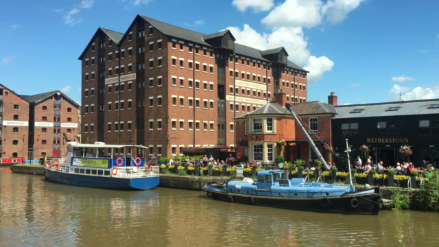 Boats and restored warehouses at Gloucester Quays.