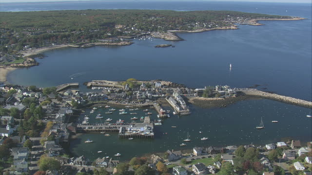 aerial boats and wharfs in rockport harbor surrounded by coastal properties / massachusetts, united states - rockport massachusetts stock videos & royalty-free footage