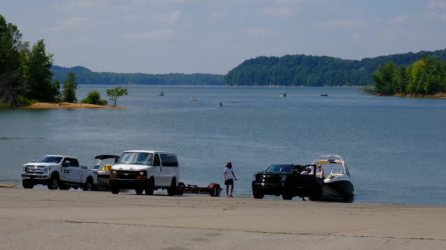 boats are launched at monroe lake's paynetown boat ramp sunday august 16 near bloomington indiana a car was driven into the lake and three occupants... - boat ramp stock videos & royalty-free footage
