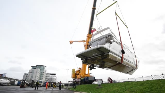 boats are lifted onto trailers outside excel london so they can be displayed at the london boat show at excel on december 18 2015 in london england... - london boat show stock videos and b-roll footage