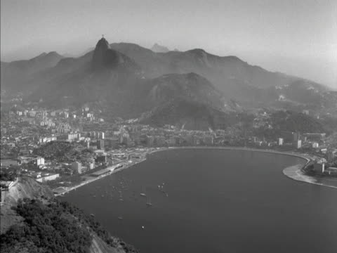boats are moored in the bay of rio de janeiro 1961 - naturwunder stock-videos und b-roll-filmmaterial
