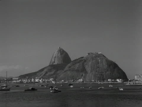 boats are moored in the bay of rio de janeiro. 1961. - naturwunder stock-videos und b-roll-filmmaterial